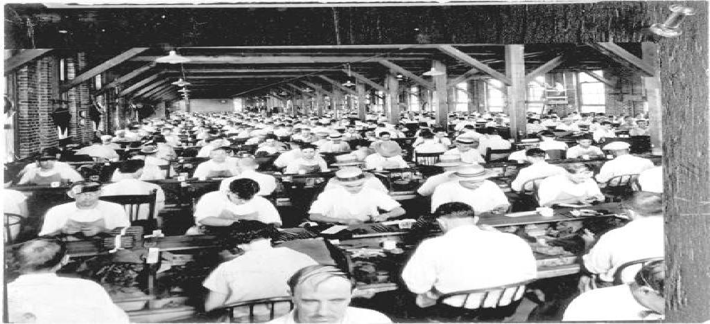 Employees hand rolling cigars in the cigar factory in Ybor City, Florida